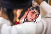 08 FEBRUARY 2013 - BANGKOK, THAILAND:  A Chinese opera performer puts on his makeup before performing at Seacon Square in Bangkok. Chinese opera is popular in Thailand and is usually performed in the Teochew language. The weeks surrounding Chinese New Year are important for retailers in Thailand and many malls put on special promotions and events honoring Chinese culture, like Lion Dances or Chinese Opera. Thailand has a large Thai-Chinese population. Millions of Chinese emigrated to Thailand (then Siam) in the 18th and 19th centuries and brought their cultural practices with them.   PHOTO BY JACK KURTZ