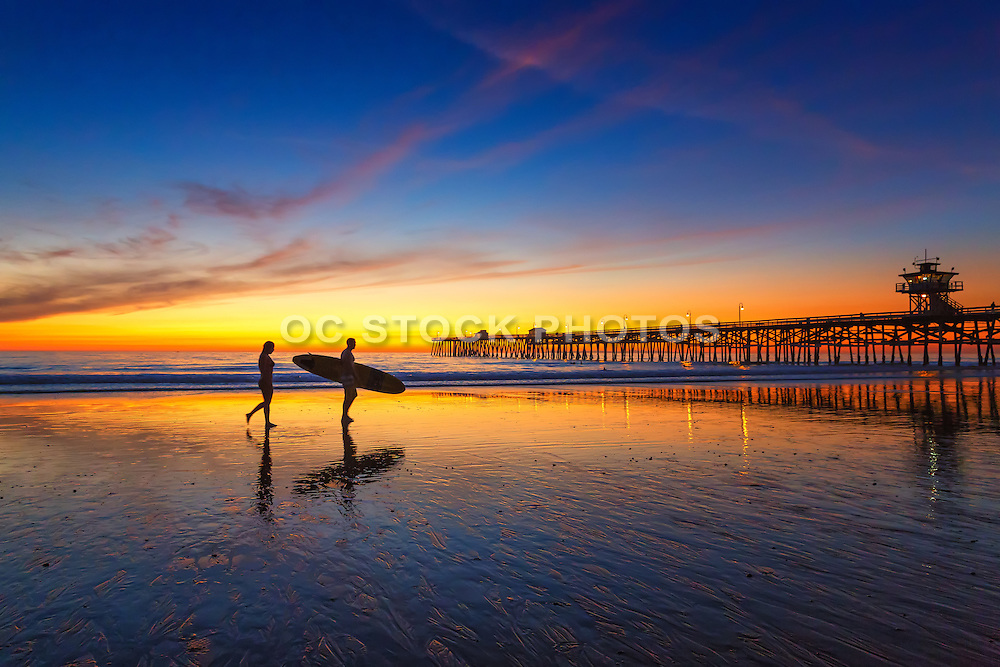 Long Board Surfer at Low Tide by the San Clemente Pier at Susnet