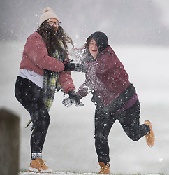© Licensed to London News Pictures. 08/02/2021. Dunstable, UK. Two women enjoy a snowball fight in freezing conditions on Dunstable Downs in Bedfordshire. Strong easterly winds from Ukraine and the Black Sea are expected to last in to the middle of the week. Photo credit: Ben Cawthra/LNP