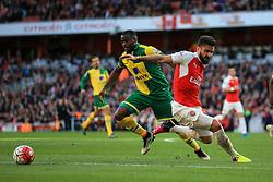 Sebastien Bassong of Norwich City tackles Olivier Giroud of Arsenal - Mandatory byline: Jason Brown/JMP - 07966386802 - 30/04/2016 - FOOTBALL - Emirates Stadium - London, England - Arsenal v Norwich City - Barclays Premier League