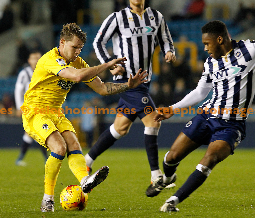 AFC Wimbledon's Jake Reeves is foiled by Millwall's  Mahlon Romeo during the Sky Bet League 1 match between Millwall and AFC Wimbledon at The Den in London. November 22, 2016.<br /> Carlton Myrie / Telephoto Images<br /> +44 7967 642437