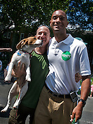 WASHINGTON, DC - July 4, 2009: The fifth Mayor of the District of Columbia Adrian M. Fenty stops to meet with people during a parade in the nations capitol to celebrate Independence Day in the Palisades neighborhood of northwest Washington, DC.  Photo by Johnny Bivera