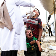 Syrian refugees children who fled the Turkish incursion in Rojava receive medicine for polio and measles as more than 200 arrive at the facility in Dohuk, Iraq onThursday, October 17, 2019. More than 1000 refugees have arrived in Northern Iraq since the beginning of the conflict, with many saying they paid to be smuggled through the Syrian border.