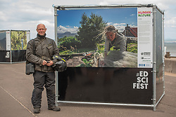 The first event of the 2021 Edinburgh Science Festival opened today on Portobello Promenade. The Human Nature photography exhibition features work of a range of critically acclaimed photographers, including Lucas Foglia whose photographs often feature in the National Geographic and New York Times and Anna Deacon, an Edinburgh-based photographer and author known for her portraits of wild swimmers. Photographer Ed Gold, who had travelled up from South Wales to take in the exhibition en route to a photography job in Fife, in front of one of his images in the exhibition.<br /> <br /> <br /> © Jon Davey/ EEm
