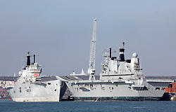 © under license to London News Pictures.  23/03/201. Bow to bow for the final time, HMS Invincible (L) and HMS Ark Royal (R) wait in Portsmouth Dockyard before being scrapped. They will be separated today when HMS Invincible is towed to Turkey to be broken up for scrap. Picture credit should read: Bryan Moffat/London News Pictures