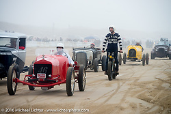 Mike Davis surveys the returning vehicles heading back to the pits from the finish line at TROG West - The Race of Gentlemen. Pismo Beach, CA, USA. Saturday October 15, 2016. Photography ©2016 Michael Lichter.