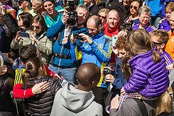 Elite runners meet and greet spectators at the finish line,