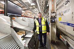 Matt shadowing Edinburgh Airport's chief exec Gordon Dewar as he runs Scotland's busiest airport. Inside the baggage hall.
