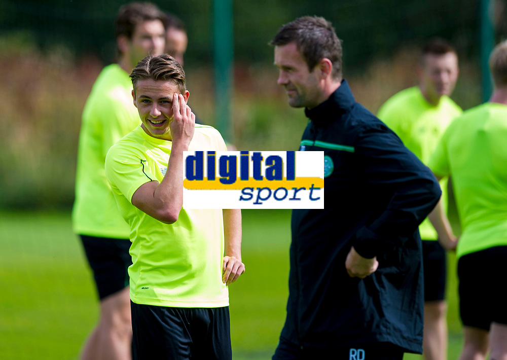 18/08/15<br /> CELTIC TRAINING<br /> LENNOXTOWN<br /> Celtic new boy Scott Allan (left) enjoys a chat with his manager Ronny Deila