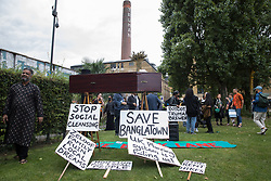 London, UK. 12th September, 2021. Local residents and supporters of the Save Brick Lane campaign chat after a funeral procession along Brick Lane organised in protest against the ongoing gentrification of Shoreditch. Campaigners are protesting in particular against plans to develop the Truman Brewery into a shopping centre and 5-storey office building. Tower Hamlets experienced more gentrification than any other London borough between 2010-2016.
