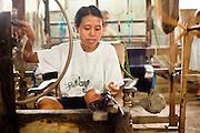Apr 23 - BALI, INDONESIA - A woman works in a weaving shop in central Bali.   Photo by Jack Kurtz/ZUMA Press