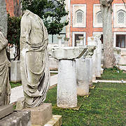 Marble statues and columns standing in the gardens of the Istanbul Archaeology Museums. The Istanbul Archaeology Museums, housed in three buildings in what was originally the gardens of the Topkapi Palace in Istanbul, Turkey, holds over 1 million artifacts relating to Islamic art, historical archeology of the Middle East and Europe (as well as Turkey), and a building devoted to the ancient orient.