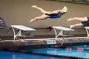 "Andrea Chan dives into lane 3 at the start of the 100 yard butterfly.  Chan finished second with a time of 1:00.22.  San Jose State's women's swimming and diving team opened the season strong against Stanford, only trailing by 43 points at the Avery Aquatics Center, Stanford University, Palo Alto, Calif., on Sept. 30, 2011.  ""This is by far the best start we've ever had here,""  said San Jose State head coach, Sage Hopkins.  The Spartans fell to Stanford 167-125. (Stan Olszewski/Spartan Daily)"