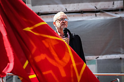 © Licensed to London News Pictures. 01/05/2016. London, UK. Jeremy Corbyn, Leader of the Labour Party, speaks from the top of a double decker bus before speaking at the opening May Day rally. Thousands gathered on Clerkenwell Green to mark May Day. Photo credit : Rob Pinney/LNP