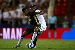 September 19, 2018 - Valencia, Spain - Alex Sandro, Michy Batshuayi (R) battle for the ball during the Group H match of the UEFA Champions League between Valencia CF and Juventus at Mestalla Stadium on September 19, 2018 in Valencia, Spain. (Credit Image: © Jose Breton/NurPhoto/ZUMA Press)
