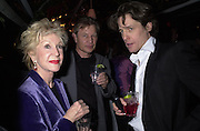 Pat York, Michael York and Hugh Grant Talk pre-Golden Globes party. Mondrian Hotel.West Hollywood, California USA  20 January 2001. © Copyright Photograph by Dafydd Jones 66 Stockwell Park Rd. London SW9 0DA Tel 020 7733 0108 www.dafjones.com