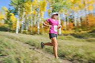 Jenny Ward runs along the Government Trail on Buttermilk in the Golden Leaf Half Marathon.