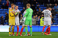 Wigan's goalkeeper Adam Bogdan (l) is congratulated on his clean sheet by team mate Jake Buxton (3) after the final whistle. EFL Skybet championship match, Cardiff city v Wigan Athletic at the Cardiff city stadium in Cardiff, South Wales on Saturday 29th October 2016.<br /> pic by Carl Robertson, Andrew Orchard sports photography.