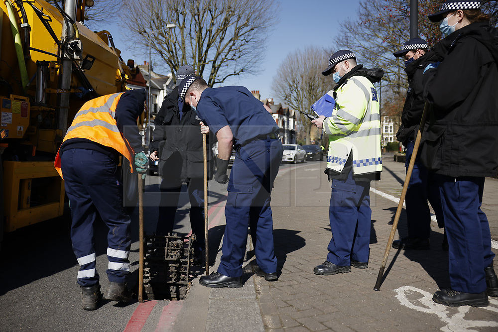 © Licensed to London News Pictures. 09/03/2021. London, UK. Police search drains on the South Circular Road near Clapham Common as officers continue to look for missing 33 year old woman Sarah Everard. Police are concerned for the safety of Ms Everard who has been missing for six days after leaving a friend's house in Leathwaite Road, Clapham, London. She is thought to have walked across Clapham Common, and was due to arrive home in Brixton 50 minutes later. Photo credit: Peter Macdiarmid/LNP