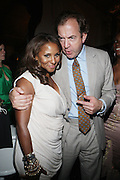 14 June 2010- Harlem, New York- l to r: Marvet Britto and Mark Cornell at The Apollo Theater's 2010 Spring Benefit and Awards Ceremony hosted by Jamie Foxx inducting Aretha Frankilin and Michael Jackson, and honoring Jennifer Lopez and Marc Anthony co- sponsored by Moet et Chandon which was held at the Apollo Theater on June 14, 2010 in Harlem, NYC. Photo Credit: Terrence Jennngs/Sipa