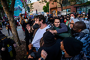 Protesters clash next to a police line during a protest honoring George Floyd's memory in downtown Oakland on May 29, 2020.