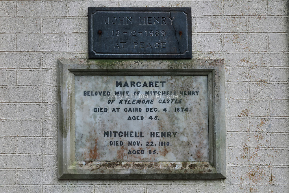 Plaque on the mausoleum, housing the bodies of Margaret Henry, died 1874, and her husband Mitchell Henry, died 1910, who built Kylemore Castle, near Kylemore Abbey Church, built in 1881 in Neo Gothic style, in Connemara, County Galway, Ireland. Kylemore Abbey is a Benedictine monastery founded in 1920 in the grounds of Kylemore Castle. Picture by Manuel Cohen