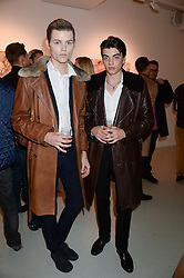 Left to right, CONOR FITZGERALD-BOND and SASCHA BAILEY at a private view of an exhibition of paintings by Billy Zane entitled 'Save The Day Bed' held at the Rook & Raven Gallery, Rathbone Place, London on 10th October 2013.