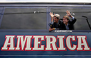 """Democratic presidential nominee John Kerry (L) and running mate John Edwards wave from their campaign bus during a stop in Newburg, New York, during the start of the two-week, cross country """"Believe in America"""" tour, in Boston, July 30, 2004.  Kerry will face U.S. President George W. Bush in the November presidential election.  REUTERS/Jim Young"""