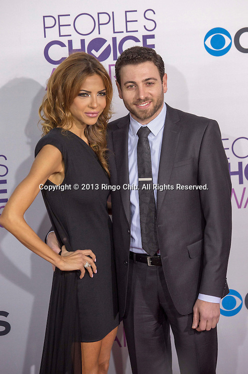 Sevan Poladian (L) and actor Hrach Titizian arrive at the 39th Annual People's Choice Awards at Nokia Theatre L.A. Live on Wednesday January 9, 2013 in Los Angeles, California, United States. (Photo by Ringo Chiu/PHOTOFORMULA.com)