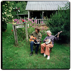 8/17/92 Mary Jane Queen and her son Henry. Mary Jane Queen lived in the Caney Fork section of Jackson County, NC near where she was born in 1914. In a variety of practical ways--her reservoir of traditional knowledge, her gardens, her songs and stories--she communicated the values and traditions of her upbringing to modern audiences through her music. L.MUELLER/The Charlotte Observer