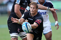 Charl McLeod of The Sharks releases the ball during the Super15 match between The Mr Price Sharks and The Blues held at Mr Price Kings Park Stadium in Durban on the 26th February 2011..Photo By:  Ron Gaunt/SPORTZPICS
