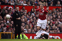 Photo: Paul Thomas.<br /> Manchester United v Aston Villa. The FA Cup. 07/01/2007.<br /> <br /> Man Utd new player Henrik Larsson (Red) is tackled by Liam Ridgewell while his old boss at Celtic (Now Villa manager, Martin O'Neill) looks on.