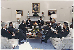Washington, DC - January 15, 1991 -- United States President George H.W. Bush meets in the Oval Office with Chairman of the Joint Chiefs of Staff General Colin Powell, National Security Advisor General Brent Scowcroft, United States Secretary of State James A. Baker III, Vice President Dan Quayle, United States Secretary of Defense Dick Cheney, White House Chief of Staff John Sununu and Robert Gates about the situation in the Persian Gulf and Operation Desert Shield on January 15, 1991. Photo by White House/CNP/ABACAPRESS.COM