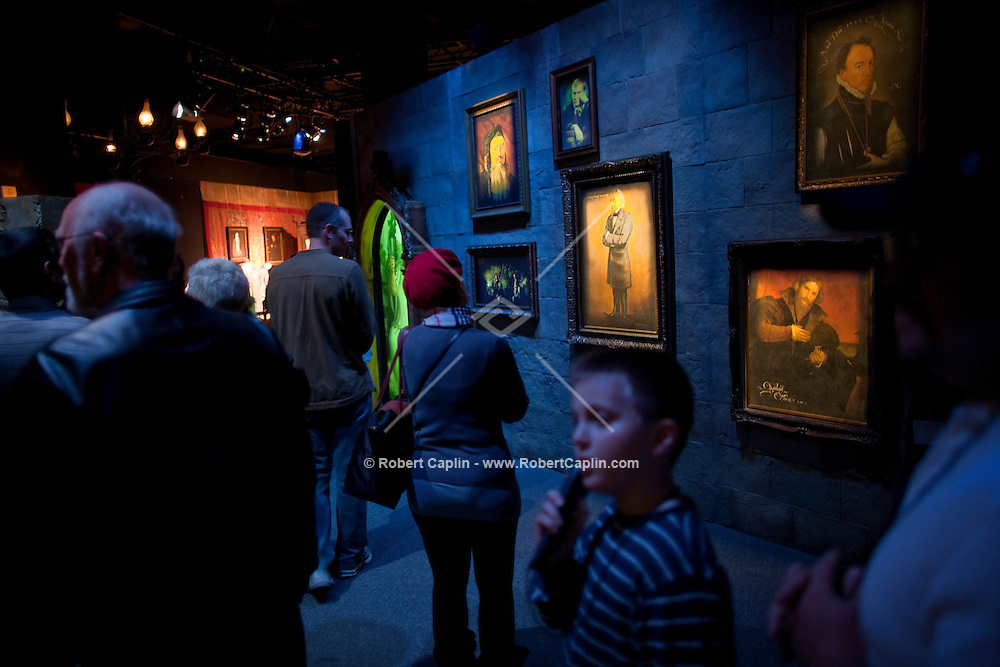 """Hans Iselborn, 9, listens to his audio tour as they enter the """"Harry Potter"""" exhibition at Discovery Times in New York. ..Photo by Robert Caplin."""