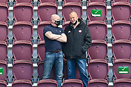 Livingston manager David Martindale (left) and Hamilton manager Brian Rice chat in the stand before the SPFL Championship match between Heart of Midlothian and Inverness CT at Tynecastle Park, Edinburgh Scotland on 24 April 2021.