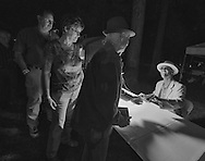 Eric Bibb signs CD cases after his performance at the festival's Friday session.