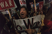 Young Japanese people and students take part in a protest rally by SEALDs activists outside the Japanese Diet building, Nagatacho, Tokyo, Japan. Friday July 10th 2015 SEALD (Student Emergency Action for Liberal Democracy) is a student activist group that is against the neoliberal policies and nationalist agenda of Japanese Prime Minister, Shinzo Abe.