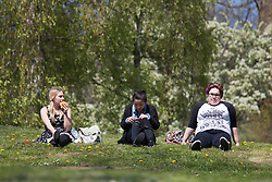 © Licensed to London News Pictures. 20/04/2015. Bristol, Avon, UK. Three women out enjoying the sunny weather in Bristol today, 20th April 2015. The South West of England is set for more warm temperatures and plenty of sunshine this week. Photo credit : Rob Arnold/LNP
