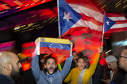 December 6, 2019, Atlanta, Georgia, USA: Fans supporting  Thalia Olvino from Venezuela, wave flags in audience before preliminary judging begins. Contestants representing 90 counties are in Atlanta this weekend for the 2019 Miss Universe Pageant (Credit Image: © Robin Rayne/ZUMA Wire)