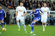 Eden Hazard of Chelsea has a shot at goal.Barclays Premier League match, Swansea city v Chelsea at the Liberty Stadium in Swansea, South Wales on Saturday 17th Jan 2015.<br /> pic by Andrew Orchard, Andrew Orchard sports photography.