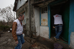Doctor Kachatur Malakyan and nurse Andrei Bogma of MSF visit the home of Pavlo Virienko, 86, and his wife Lydia, 86, as part of a follow up visit in the home visits project. Pavlo is alone in caring for his frail elderly wife and is scared to venture far from their home due to the recent fighting in the town. He recently fell and cut his face whilst trying to bring home food from a himanitarina food distribution. One of their daughters  is able to visit once a week but his other daughter lives on the other side of the frontline in Ukraine and is blocked from visiting her parents due to the security restrictions.