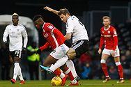 Kevin McDonald of Fulham (R) fouls Mamadou Thiam of Barnsley (L). EFL Skybet championship match, Fulham v Barnsley at Craven Cottage in London on Saturday 23rd December 2017<br /> pic by Steffan Bowen, Andrew Orchard sports photography.