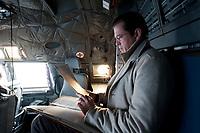 30 NOV 2010, JAGEL/GERMANY:<br /> Karl-Theodor zu Guttenberg, CSU, Bundesverteidigungsminister, liest im Cockpit in seinen Unterlagen, waehrend dem Flug mit einer Transall vom Fliegerhorst Jagel nach Berlin, nach der  Rueckkehr der in Afghanistan eingesetzten RECCE TORNADO Aufklaerungsjets<br /> IMAGE: 20101130-01-066<br /> KEYWORDS: Bundeswehr, Armee, Luftwaffe, lesen