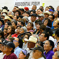 072114  Adron Gardner/Independent<br /> <br /> Guests listen to questions posed to Navajo Nation presidential candidates during an election forum at Navajo Technical University in Crownpoint Monday.