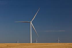 Wind farm turbines in a rural Texas field.