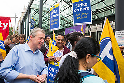 London, UK. 15 July, 2019. Mark Serwotka, General Secretary of the PCS trade union, talks to catering and cleaning staff outsourced to work at the Department for Business, Energy and Industrial Strategy (BEIS) via contractors ISS World and Aramark on the picket line outside the Government department after walking out on an indefinite strike for the London Living Wage, terms and conditions comparable to the civil servants they work alongside and an end to outsourcing.
