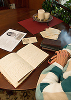Judy Buswell talks about her research through the writings of Anna Samson Bradley as seen here from a page within  Anna's journal on February 21, 1898.  (Karen Bobotas/for the Laconia Daily Sun)