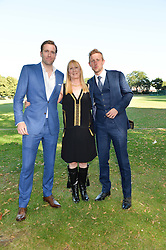 Left to right, WILFRED FROST, LADY CARINA FROST and GEORGE FROST at the Frost Family Summer party in support of the British Heart Foundation and the Mile Frost Fund held at Burton Court, Chelsea, London  on 18th July 2016.