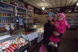 Jana, 23, and Tatiana, visit the local shop in Gorodishe, near Lugansk, having seen a doctor at the MSF mobile clinic held that morning in the village.