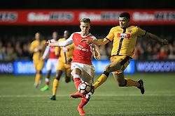 20 February 2017 - The FA Cup - (5th Round) - Sutton United v Arsenal - Rob Holding of Arsenal in action with Maxime Biamou of Sutton United - Photo: Marc Atkins / Offside.